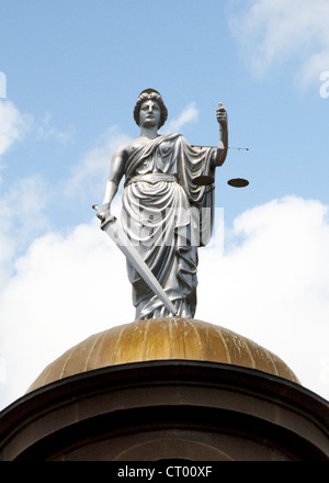 Statue of Justice on top of copper dome of 1908 Hays County Courthouse in San Marcos, Texas, USA - Stock Photo
