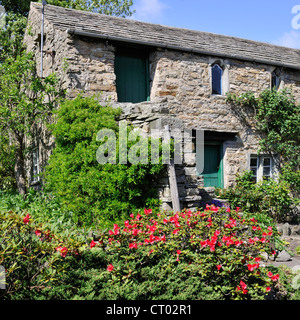 Picturesque stone outbuilding in the village of Askrigg, Wensleydale, Yorkshire, England - Stock Photo