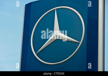 Car manufacturer Mercedes Benz Star Company Logo sign board - Stock Photo