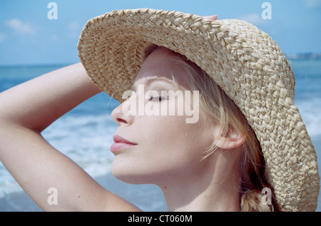 WOMAN TANNING IN SUMMER - Stock Photo