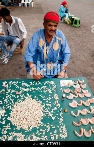 Dentist stall with teeth, plates and false teeth, Djemaa el Fna square Marrakech Morocco Africa - Stock Photo