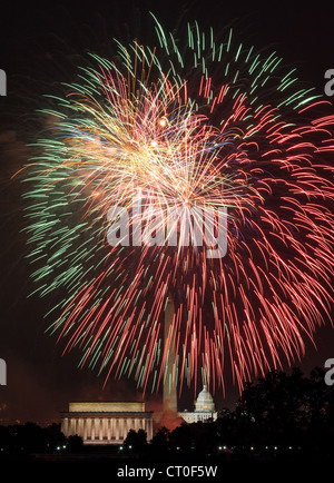 Independence Day fireworks celebrations over monuments in Washington DC - Stock Photo