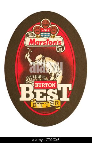 Beer Mat / drip mat - Marston's Brewery, Burton upon Trent, England featuring an advert for Burton Best Bitter. - Stock Photo
