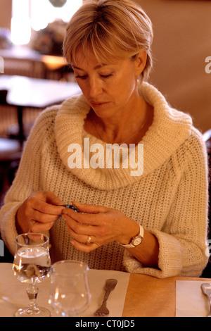 ELDERLY PERSON TAKING MEDICATION - Stock Photo