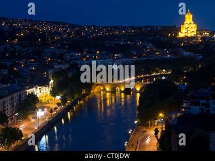 Kura river in the town of Tbilisi (capital of the Republic of Georgia) at night. - Stock Photo
