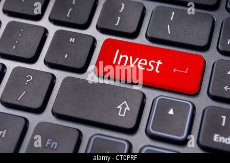 invest or investing concepts, with a message on enter key or keyboard. - Stock Photo