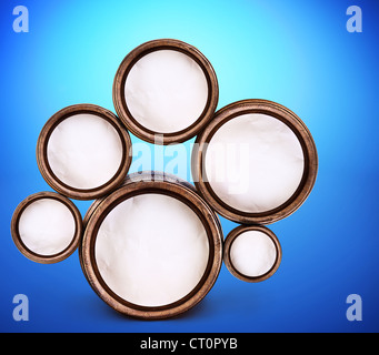Abstract design of round shapes in the form of beer barrels on a blue background. Inside the barrels textured watercolor - Stock Photo