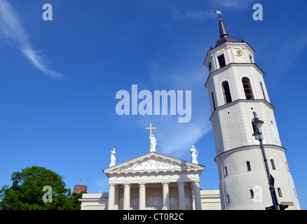 Vilnius cathedral bell tower and Gediminas castle fort on high hill against cloudy sky. - Stock Photo