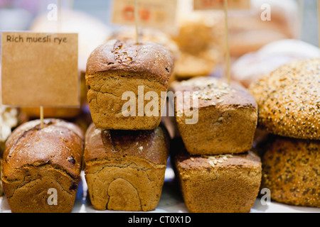 Stacks of fresh bread for sale - Stock Photo