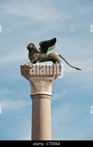 Venice, Italy. Piazza San Marco (St Mark's Square). Column bearing a winged lion, symbol of St Mark, one of the - Stock Photo