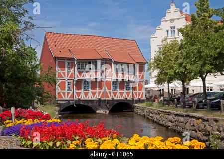 frame house called Gewoelbe built across River Grube, Wismar, Mecklenburg-West Pomerania, Germany - Stock Photo