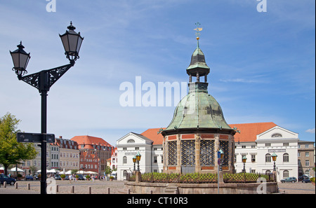 market square with Wasserkunst and town hall, Wismar, Mecklenburg-West Pomerania, Germany - Stock Photo