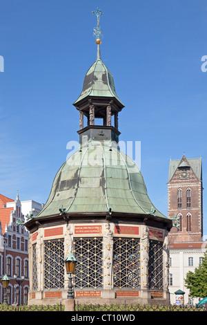 Wasserkunst, and Tower of St. Marien Church, Wismar, Mecklenburg-West Pomerania, Germany - Stock Photo
