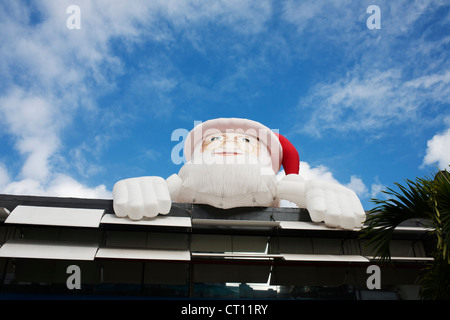 Inflatable Santa Claus over building