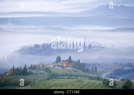 Pienza - Misty early morning view across Val d'Orcia - Stock Photo