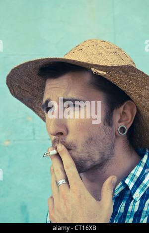 Close up of man smoking cigarette - Stock Photo