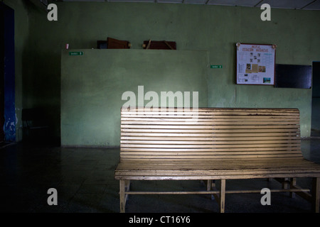Wooden bench in waiting area - Stock Photo