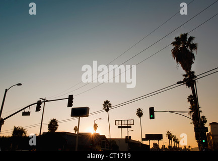 Silhouette of city street at sunset - Stock Photo