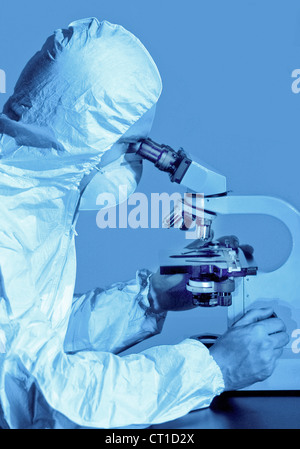 scientist at a microscope - Stock Photo