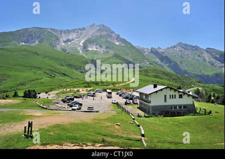 Cars and motorhomes at parking place of restaurant on the Col du Soulor, Hautes-Pyrénées, Pyrenees, France - Stock Photo