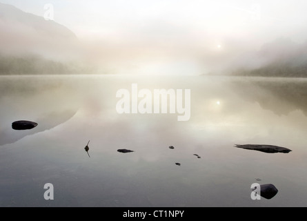 Sunrise misty dawn on Llyn Dinas Lake in the Nantgwynant Valley Snowdonia National Park Gwynedd North Wales UK - Stock Photo