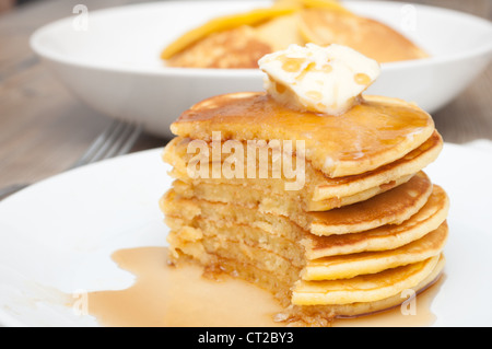 Homemade Pancakes With Butter and Warm Maple Syrup - Stock Photo