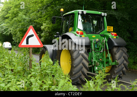Road sign on approach to a sharp bend - Stock Photo