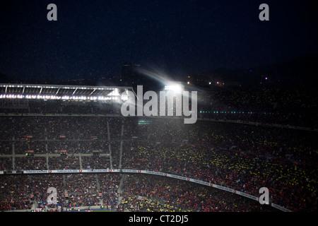 Rain during a soccer match in FC Barcelona stadium - Stock Photo