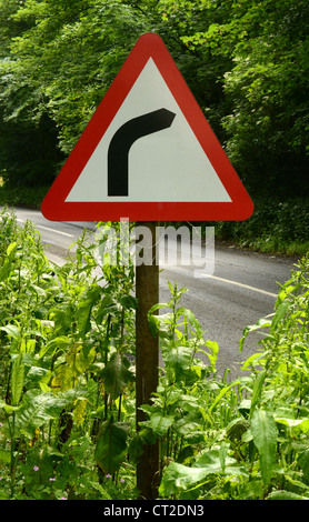 Sharp right hand bend sign on a country road in UK - Stock Photo