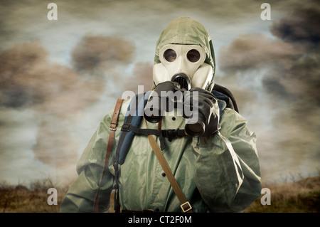 Man in gas mask with binocular on war - Stock Photo