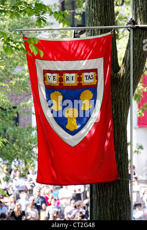 Harvard Law School flag flying over the crowd at Harvard Commencement 2011 in Cambridge, MA. - Stock Photo