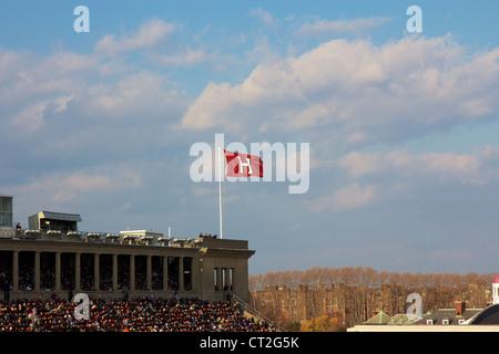 Harvard University's athletics 'H' flag streaming at the Harvard - Yale football game on November 20, 2010 in Cambridge, - Stock Photo