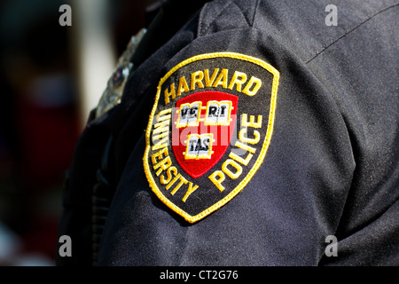 Harvard University Police Department (HUPD) patch on the sleeve of an officer's uniform. - Stock Photo