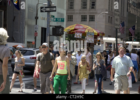 5th Avenue is always busy with pedestrians in NYC. - Stock Photo