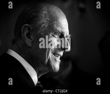 HRH Prince Phillip, Duke of Edinburgh lit from a window in black and white - Stock Photo