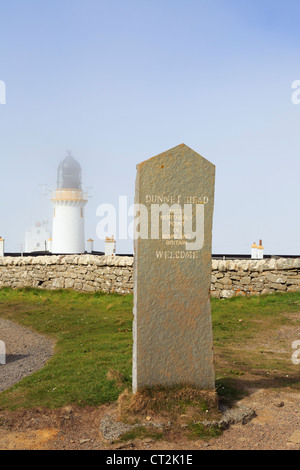 Stone welcome sign for Dunnet Head lighthouse in mist at most northerly point of mainland Britain. Dunnet Caithness - Stock Photo