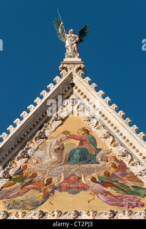 Gable of Facade of Cathedral (Duomo) of Siena with Mosaic representing Coronation of Virgin by Luigi Mussini, Tuscany, - Stock Photo