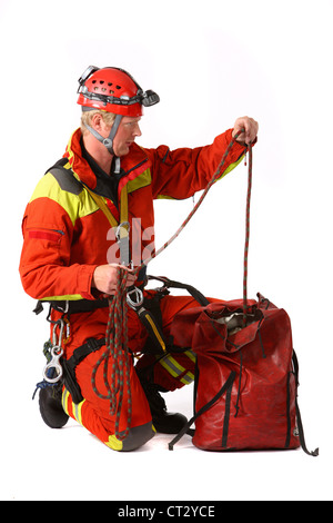Fire men specialist for rescuing people from heights and out of deep holes. Height savior, fire service, fire brigade. - Stock Photo