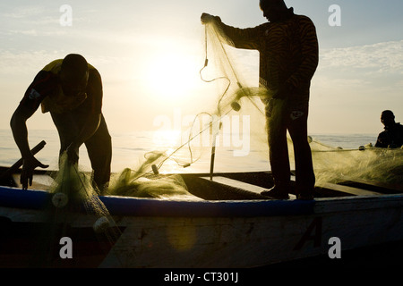 Fishermen pull in their nets while fishing off the coast near Cape Coast, Central Region, Ghana. - Stock Photo