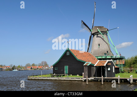 windmill on river, Zaanse Schans view of traditional windmill at touristic location, shot in bright spring light - Stock Photo