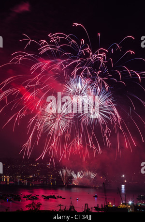 Growing red fireworks over Lake Union Washington - Stock Photo