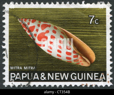 Postage stamps printed in Papua New Guinea, is depicted shell Mitra mitra (Episcopal miter), circa 1969 - Stock Photo