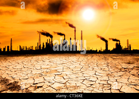Refinery with smoke and global warming concept - Stock Photo