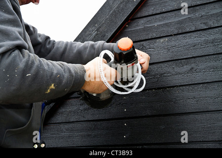 Builder at work on new structure - Stock Photo
