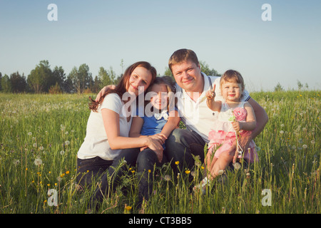 Happy parents with their two daughters - Stock Photo