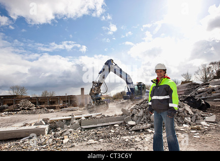 Worker standing on construction site - Stock Photo