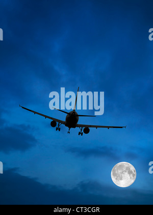 Airplane and Moon in Blue Sky - Stock Photo