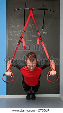 Man working out in gym - Stock Photo