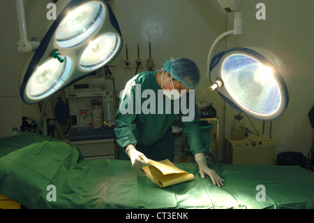 A surgeon looking over patient notes before a procedure. - Stock Photo