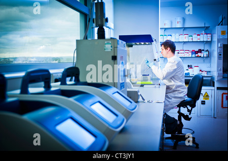 Scientist using computer in lab - Stock Photo